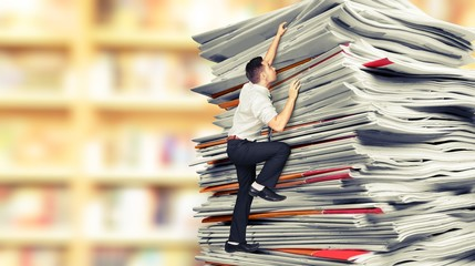 Businessmen climbing up a pile of documents on backround