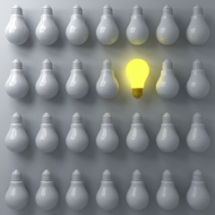One glowing light bulb standing out from the unlit or dim bulbs on dark white background individuality and think different the business creative idea concepts 3D rendering