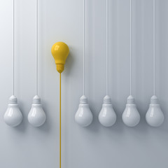 Think different concept One hanging yellow light bulb standing out from the white light bulbs on white wall background with shadows leadership and individuality creative idea concepts 3D rendering