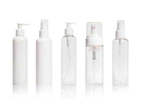Set of blank cosmetic bottles close-up on white background