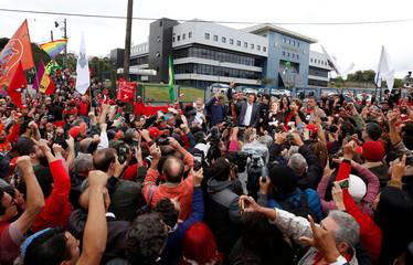 Workers Party Presidential candidate Fernando Haddad, gestures to his supporters in front of the Federal Police headquarters, where Brazilian former President Luiz Inacio Lula da Silva is imprisoned, in Curitiba