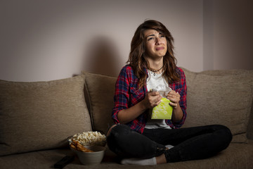 Woman watching a drama movie and sobbing