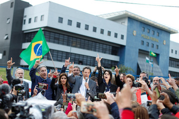 Workers Party Presidential candidate Fernando Haddad, peaks in front of the Federal Police headquarters, where former Brazilian President Luiz Inacio Lula da Silva is imprisoned, in Curitiba