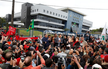 Workers Party Presidential candidate Fernando Haddad, applauds as Senator Gleisi Hoffmann speaks in front of the Federal Police headquarters, where former Brazilian President Luiz Inacio Lula da Silva is imprisoned, in Curitiba