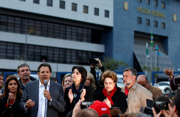 Workers Party Presidential candidate Fernando Haddad, speaks next to his vice presidential candidate Manuela d'Avila in front of the Federal Police headquarters, where Brazilian former President Luiz Inacio Lula da Silva is imprisoned, in Curitiba