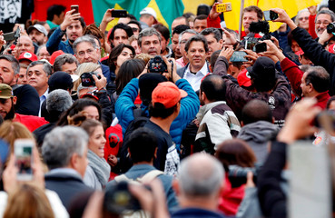 Workers Party Presidential candidate Fernando Haddad, is seen with supporters in front of the Federal Police headquarters, where Brazilian former President Luiz Inacio Lula da Silva is imprisoned, in Curitiba
