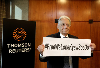 Brazil's former President Cardoso shows solidarity for Reuters journalists Wa Lone, 32, and Kyaw Soe Oo, 28, who are imprisoned in Myanmar, in Sao Paulo