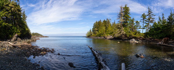 Beautiful panoramic view of a rocky beach during a vibrant sunny summer day. Taken in Port Hardy, Northern Vancouver Island, BC, Canada.