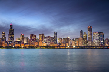 Chicago cityscape skyline looking out from the Adler Planetarium across Lake Michigan in Illinois USA