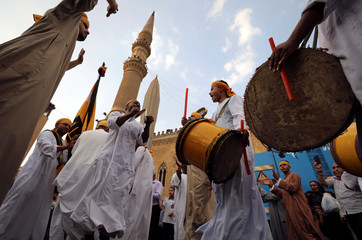 Egyptian Sufi Muslims practise ritualized Zikr (invocation) to celebrate the Islamic New Year outside the Al-Hussein mosque in old Cairo