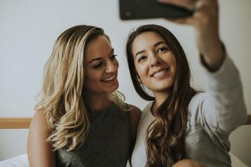 Lesbian couple taking a selfie