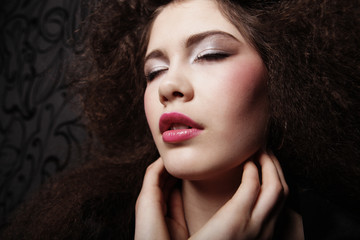 Glamour girl with bright makeup and closed eyes. Beauty female.