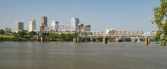 The Arkansas River flows by the Little Rock Waterfront under Bridges and Tresles