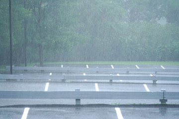 parking lot in the heavy rain in summer thunderstorm