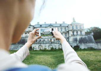 woman tourist seeing and photographing old historic places