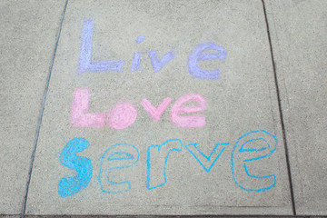 Chalk on sidewalk live love serve