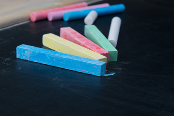on blackboard close-up, colorful chalk for writing