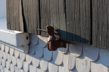 wooden fishscale facade of farmhouse