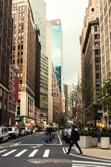 Fotobehang New York Broadway street in Manhattan's midtown by early evening, New York City, United States. Toned image