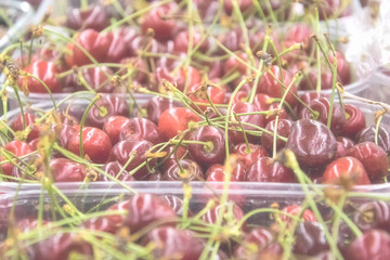 Cherry in the trays in the store.