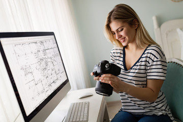 Portrait of young woman designing at home