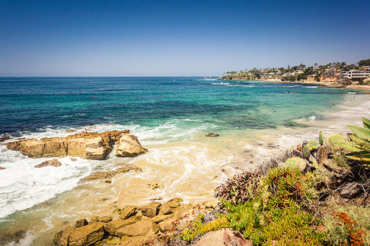 Laguna beach with rock in pacific ocean view