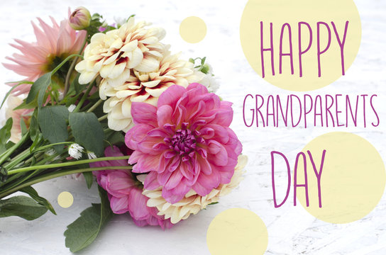 Beautiful dahlias on wooden background. Bouquet of colored dahlias. Happy grandparents day.