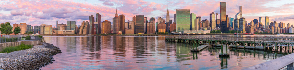 View to Manhattan skyline from the Long Island City at sunrise Wall mural