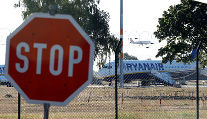 Ryanair aircraft is seen on a parking position as Ryanair pilots and cabin crew stage a 24-hour strike affecting flights out of Germany, at Schoenefeld Airport, south of Berlin
