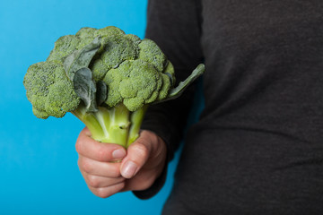 Diet agricultural broccoli in hand.