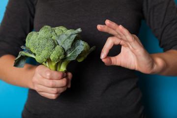 Vegetarian lifestyle concept, hands holding vegetable for diet.