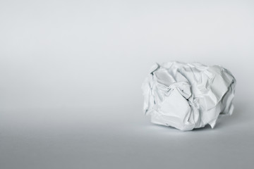 crumpled paper on grey background