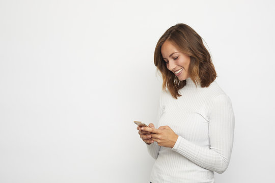 young woman with mobile looking down