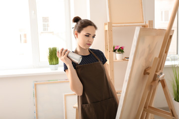 Female artist waiting for inspiration in workshop