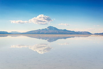 Miror effect and reflection of mountain in Salar de Uyuni (Uyuni salt flats), Potosi, Bolivia, South America