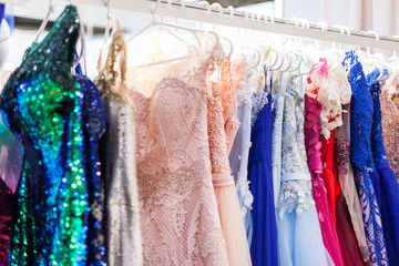 Rack with chic evening dresses.