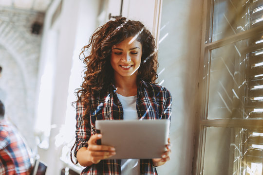 Young student woman online via digital tablet