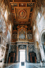 Salvatore Church in Rome, view from outside and inside. Frescoes and statues, architectural elements. A historic landmark, tourist destination. Ancient painting