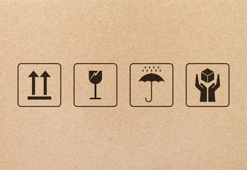 Black fragile sign and symbol on brown cardboard paper. Fragile symbol illustration.