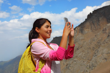 Woman traveler take photo with mobile phone