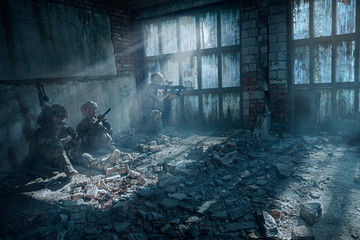Special Forces soldiers in action. Elite squad in a dilapidated building.They use special equipment, weapons and tactical devices