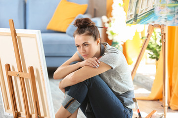Female artist waiting for inspiration in workshop