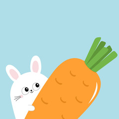 White bunny rabbit holding big carrot. Funny head face, eyes, ears. Cute kawaii cartoon character. Baby greeting card template. Happy Easter sign symbol. Blue background. Flat design.