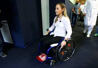 Germany's Olympic and world sprint cycling champion Kristina Vogel leaves a news conference in Berlin
