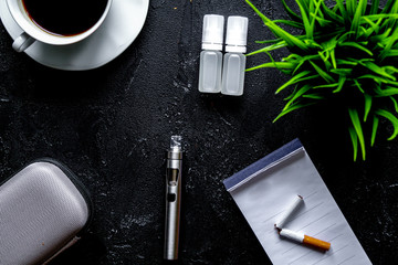 concept of electronic cigarette on dark background top view