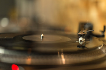 Playing vinyl on blurred background