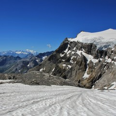 Tsanfleuron Glacier and distant view of Mont Blanc. View from Diablerets Glacier. Glacier 3000, Switzerland.