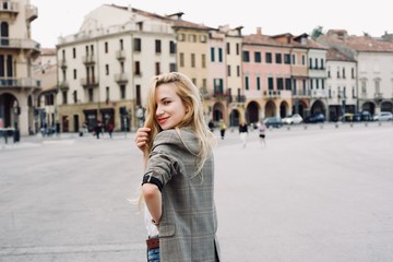 Beautiful young student hipster tourist girl in the city during summer period Fototapete
