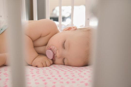 Cute little baby sleeping in crib