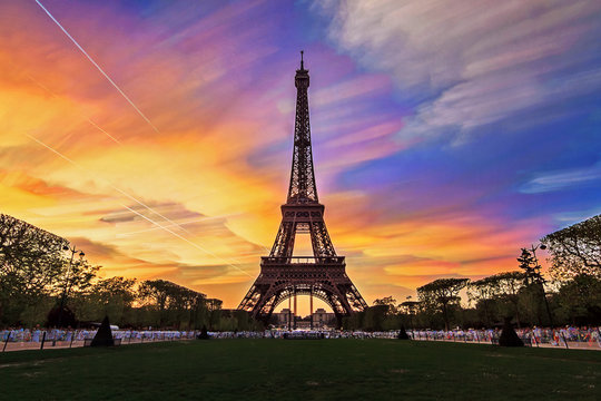 Composite timelapse image of sunset clouds at the Eiffel tower in spring in Paris, France